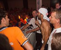 14-sept.-2013,Netherlands, Groningen,  Martini Plaza, Tennis, DavisCup Netherlands-Austria, ,  Dutch Team celebration with students , Jean-Julien Rojer,  playing music and singing<br /> Photo: Henk Koster