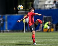 GRENOBLE, FRANCE - JUNE 12: Soyun Ji #10 of the Korean National Team traps the ball during a game between Korea Republic and Nigeria at Stade des Alpes on June 12, 2019 in Grenoble, France.
