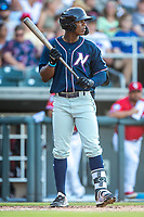 Northwest Arkansas Naturals outfielder Dairon Blanco (15) steps to the plate against the Wichita Wind Surge at Riverfront Stadium on July 9, 2021 in Wichita, Kansas. (William Purnell/Four Seam Images)