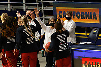 BERKELEY, CA - DECEMBER 13: Head coach Tara VanDerveer and assistant coach Katy Steding of the Stanford Cardinal high-five with the players as they leave the court before a game between University of California-Berkeley and Stanford Women's Basketball at Haas Pavilion on December 13, 2020 in Berkeley, California.