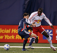 New York Red Bulls midfielder (17) Josmer Altidore is marked by New England Revolution defender (6) Jay Heaps. The New York Red Bulls and the New England Revolution played to a 0-0 tie during first leg of the MLS Eastern Conference Semifinal Series at Giants Stadium in East Rutherford, NJ, on October 27, 2007.