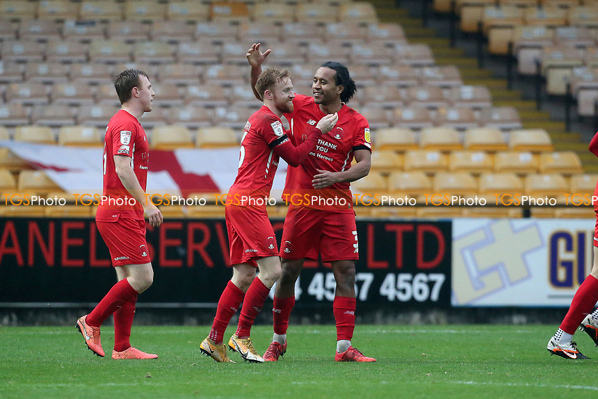 O's Joe Widdowson (right) celebrates with winning goalscorer James Brophy during Port Vale vs Leyton Orient, Sky Bet EFL League 2 Football at Vale Park on 28th November 2020