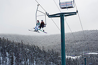 People ride the Prospector double chair at Showdown Ski Area on King's Hill in the Little Belt Mountains near Neihart, Montana, USA.