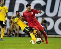 NASHVILLE, TN - JULY 3: Devon Williams #22 and Weston Mckennie #8 contest the ball during a game between Jamaica and USMNT at Nissan Stadium on July 3, 2019 in Nashville, Tennessee.