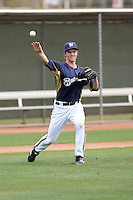 Zack Greinke #13 of the Milwaukee Brewers participates in pitchers fielding practice during spring training workouts at the Brewers complex on February 18, 2011  in Phoenix, Arizona. .Photo by Bill Mitchell / Four Seam Images.
