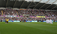 Watford and Swansea players observe a minute's silence for the 50th anniversary of the Aberfan disaster prior to the Premier League match between Swansea City and Watford at The Liberty Stadium on October 22, 2016 in Swansea, Wales, UK.