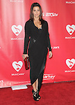 Gina Gershon at The MusiCares® 2013 Person Of The Year Tribute held at The Los Angeles Convention Center, West Hall in Los Angeles, California on February 08,2013                                                                   Copyright 2013 Hollywood Press Agency