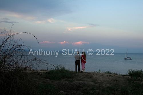 Odessa, Ukraine<br /> August 25, 2005 <br /> <br /> Sunset on the beach.