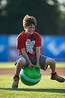 Young fan performs in an on field promotion during a Batavia Muckdogs game against the Mahoning Valley Scrappers on June 24, 2015 at Dwyer Stadium in Batavia, New York.  Batavia defeated Mahoning Valley 1-0 as three Muckdogs pitchers combined to throw a perfect game.  (Mike Janes/Four Seam Images)