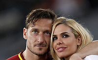 Calcio, Serie A: Roma, stadio Olimpico, 28 maggio 2017.<br /> AS Roma's Francesco Totti and his wife the Italian showgirl Ilary Blasi during a ceremony to celebrate his last match with AS Roma after the Italian Serie A football match between AS Roma and Genoa at Rome's Olympic stadium, May 28, 2017.<br /> Francesco Totti's final match with Roma after a 25-season career with his hometown club.<br /> UPDATE IMAGES PRESS/Isabella Bonotto
