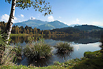 Austria, Tyrol, near Kitzbuhel: idyllic Schwarzsee (Black Lake) on the outskirts of Kitzbuhel, at background mountain Kitzbuheler Horn