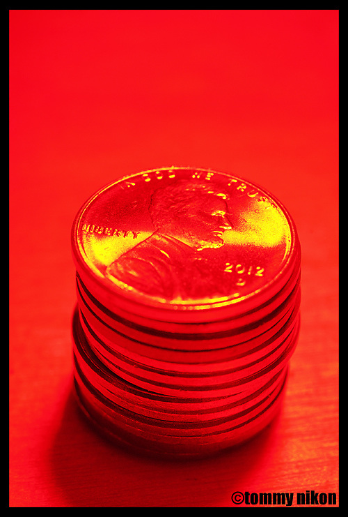 Stack of pennies with red filter