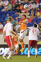 Brian Ching (25) of the Houston Dynamo  heads the ball. The New York Red Bulls defeated the Houston Dynamo 2-1 during a Major League Soccer (MLS) match at Red Bull Arena in Harrison, NJ, on June 2, 2010.