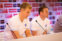Goalkeeper Joe Hart and Wayne Rooney of England look dejected during the press conference