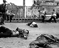 South-Vietnam - May 1968. <br /> EXACT DATE SHOT UNKNOWN - File Photo -<br /> With fear and apprehension showing on their faces, and at the urging of South Vietnamese troops, women and children loaded down with salvaged possessions scurry past the bodies of three Viet Cong killed in the fighting.