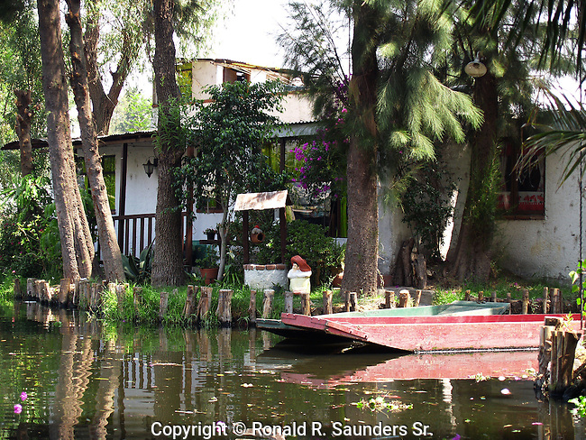 """[UNESCO WORLD HERITAGE SITE]<br /> <br />  Xochimilco is one of the sixteen boroughs within Mexican Federal District. Today, the borough consists of eighteen neighborhoods along with fourteen villages that surround it. While the neighbhoods are somewhat in the geographic center of the Federal District, it is considered to be """"south"""" and has an identity separate from the historic center of Mexico City. Xochimilco is best known for its canals, which are left from what was an extensive lake and canal system that connected most of the settlements of the Valley of Mexico. These canals, along with artificial islands called chinampas, attract tourists and other city residents to ride on colorful gondolas called<br /> """"trajineras"""" Its Hispanic past, has made Xochimilco a World Heritage Site.[UNESCO WORLD HERITAGE SITE]<br /> <br />  Xochimilco is one of the sixteen boroughs within Mexican Federal District. Today, the borough consists of eighteen neighborhoods along with fourteen villages that surround it. While the neighbhoods are somewhat in the geographic center of the Federal District, it is considered to be """"south"""" and has an identity separate from the historic center of Mexico City. Xochimilco is best known for its canals, which are left from what was an extensive lake and canal system that connected most of the settlements of the Valley of Mexico. These canals, along with artificial islands called chinampas, attract tourists and other city residents to ride on colorful gondolas called<br /> """"trajineras"""" Its Hispanic past, has made Xochimilco a World Heritage Site."""
