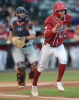 Arkansas first baseman Brady Slavens runs to first Friday, April 2, 2021, as Auburn catcher Ryan Dyal prepares to throw to first to complete the strikeout during the second inning of play at Baum-Walker Stadium in Fayetteville. Visit nwaonline.com/210403Daily/ for today's photo gallery. <br /> (NWA Democrat-Gazette/Andy Shupe)