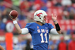 Southern Methodist Mustangs quarterback Garrett Gilbert (11) in action during the game between the Rutgers Scarlet Knights and the SMU Mustangs at the Gerald J. Ford Stadium in Dallas, Texas.  Rutgers leads SMU 21 to 7 at halftime.