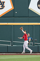 Texas Tech Red Raiders outfielder Kurt Wilson (8) makes a catch during Game 5 of the NCAA College World Series against the Arkansas Razorbacks on June 17, 2019 at TD Ameritrade Park in Omaha, Nebraska. Texas Tech defeated Arkansas 5-4. (Andrew Woolley/Four Seam Images)