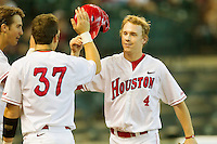 Cory Kay #4 of the Houston Cougars is congratulated by teammate John Cannon #37 after hitting a solo home run against the Arkansas Razorbacks at Minute Maid Park on March 3, 2012 in Houston, Texas.  The Cougars defeated the Razorbacks 4-1.  Brian Westerholt / Four Seam Images