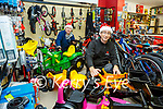 Santa's Helpers front Eamon Casey from Casey Cycles and Connie O'Connor with some items that Santa will be looking for this Christmas in Cahersiveen.