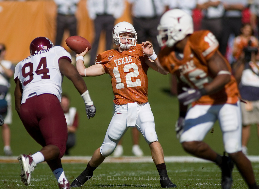24 November 2006: Texas quarterback Colt McCoy (#12) unleashes a pass during the Longhorns game against the Texas A&M University Aggies at the Darrell K Royal Memorial Field in Austin, TX.