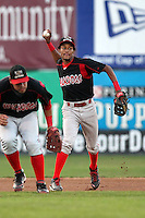 Batavia Muckdogs shortstop Yunier Castillo throws over third baseman Jon Rodriguez during a game vs. the Jamestown Jammers at Russell Diethrick Park in Jamestown, New York September 1, 2010.   Batavia defeated Jamestown 10-5.  Photo By Mike Janes/Four Seam Images
