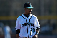 Coastal Carolina Chanticleers third baseman Eric Brown (20) on defense against the Illinois Fighting Illini at Springs Brooks Stadium on February 22, 2020 in Conway, South Carolina. The Fighting Illini defeated the Chanticleers 5-2. (Brian Westerholt/Four Seam Images)
