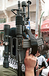 A Palestinan masked gunmen holds his M16 assault rifle during a demonstration in the memory of al Nakba May 15, 2001 in the West Bank town of Ramallah. Palestinians called for peaceful marches across the West Bank and Gaza. A siren for three minutes was to punctuate the commemoration of the Nakba, or Great Catastrophe, when 700,000 Palestinians became refugees in the Arab-Israeli war that followed Israel's birth in 1948. Photo by Quique Kierszenbaum