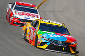 Monster Energy NASCAR Cup Series<br /> Toyota Owners 400<br /> Richmond International Raceway, Richmond, VA USA<br /> Sunday 30 April 2017<br /> Kyle Busch, Joe Gibbs Racing, M&M's Toyota Camry and Landon Cassill, Front Row Motorsports, The Pete Store Ford Fusion<br /> World Copyright: Russell LaBounty<br /> LAT Images<br /> ref: Digital Image 17RIC1Jrl_5300