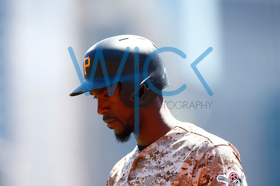 Andrew McCutchen #22 of the Pittsburgh Pirates walks back to the dugout against the Detroit Tigers during the game at PNC Park in Pittsburgh, Pennsylvania on April 14, 2016. (Photo by Jared Wickerham / DKPS)