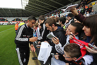 Wednesday, 23 April 2014<br /> Pictured: Neil Taylor signing autographs for supporters.<br /> Re: Swansea City FC are holding an open training session for their supporters at the Liberty Stadium, south Wales,