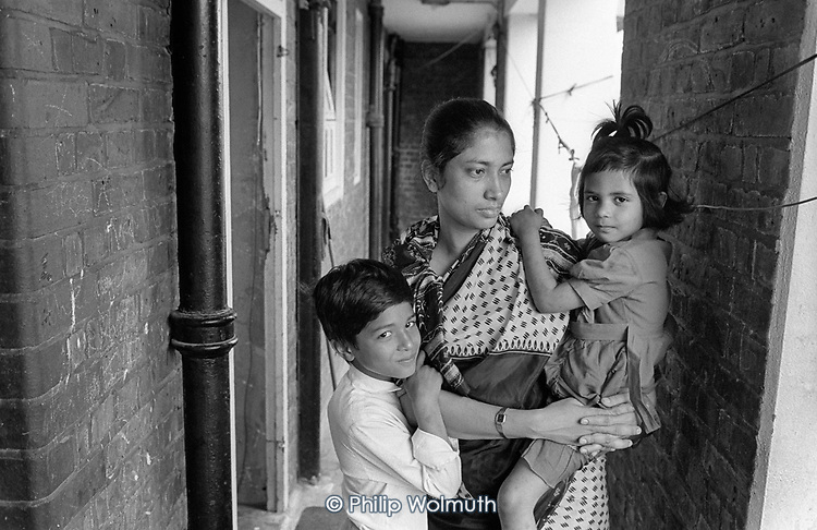 Part of a Bangladeshi family of two adults and five children living in an unfit two-bedroom council flat in Levita House, Kings Cross, London 1990.