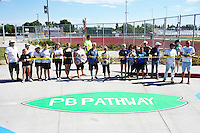 Mission Bay High School, San Diego CA, USA.  Saturday, October 10th 2015:  Mission Bay High School students, staff and alumni along with community members cut the ribbon after painting a street mural in front of the High School Gym.  The mural installation was funded by the non-profit organization Beautiful PB throgh a grant from SANDAG.