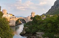 View along the river of the old reconstructed bridge. Sunset late afternoon light. Sunset late afternoon light. Historic town of Mostar. Federation Bosne i Hercegovine. Bosnia Herzegovina, Europe.