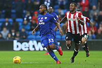 Junior Hoilett of Cardiff City is marked by Josh Clarke of Brentford during the Sky Bet Championship match between Cardiff City and Brentford at the Cardiff City Stadium, Wales, UK. Saturday 18 November 2017