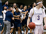 SIOUX FALLS, SD - MARCH 8: Oral Roberts Golden Eagles celebrate their 90-88 win at the buzzer over the South Dakota State Jackrabbits during the Summit League Basketball Tournament at the Sanford Pentagon in Sioux Falls, SD. (Photo by Richard Carlson/Inertia)