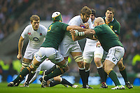 Geoff Parling of England is tackled by Juandré Kruger (left) and Gurthrö Steenkamp of South Africa during the QBE Autumn International match between England and South Africa at Twickenham on Saturday 24 November 2012 (Photo by Rob Munro)