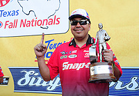 Sept. 25, 2011; Ennis, TX, USA: NHRA funny car driver Cruz Pedregon celebrates after winning the Fall Nationals at the Texas Motorplex. Mandatory Credit: Mark J. Rebilas-