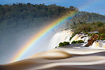 Rainbow at Iguasu Falls (also Iguazu Falls, Iguazú Falls, Iguassu Falls or Iguaçu Falls) on the Iguasu River, Brazil / Argentina border. Photographed from the Argentinian side of the Falls. Argentina.