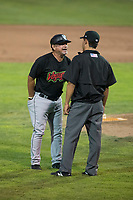 Great Falls Voyagers manager Tim Esmay (10) argues with field umpire Rene Gallegos during a Pioneer League against the Ogden Raptors at Lindquist Field on August 23, 2018 in Ogden, Utah. The Ogden Raptors defeated the Great Falls Voyagers by a score of 8-7. (Zachary Lucy/Four Seam Images)