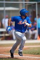 New York Mets outfielder Tim Tebow (15) runs to first base during a minor league Spring Training game against the Miami Marlins on March 26, 2017 at the Roger Dean Stadium Complex in Jupiter, Florida.  (Mike Janes/Four Seam Images)