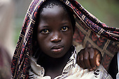 Chipundu, Zambia. Young girl with a printed cloth over her head.
