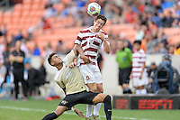 Houston, TX - Friday December 11, 2016: Logan Langsdorf (2) of the Stanford Cardinal heads the ball over Logan Gdula (17) of the Wake Forest Demon Deacons at the NCAA Men's Soccer Finals at BBVA Compass Stadium in Houston Texas.