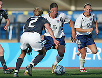 23 August 2004:   Abby Wambach dribbles the ball away from Germany defender Kerstin Stegemann during the semifinal game at Pankritio Stadium in Heraklio, Greece.     USA defeated Germany, 2-1 in overtime,  .   Credit: Michael Pimentel / ISI