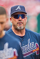 22 June 2014: Atlanta Braves Manager Fredi Gonzalez stands in the dugout during a game against the Washington Nationals at Nationals Park in Washington, DC. The Nationals defeated the Braves 4-1 to split their 4-game series and take sole possession of first place in the NL East. Mandatory Credit: Ed Wolfstein Photo *** RAW (NEF) Image File Available ***
