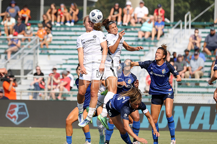 CARY, NC - SEPTEMBER 12: Lindsey Horan #10 of the Portland Thorns FC wins a header during a game between Portland Thorns FC and North Carolina Courage at Sahlen's Stadium at WakeMed Soccer Park on September 12, 2021 in Cary, North Carolina.