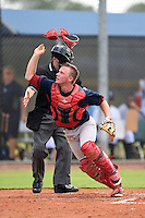 GCL Red Sox catcher Simon Gravel (15) tosses his mask while looking for a third strike passed ball during a game against the GCL Rays on June 24, 2014 at Charlotte Sports Park in Port Charlotte, Florida.  GCL Red Sox defeated the GCL Rays 5-3.  (Mike Janes/Four Seam Images)