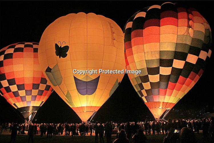 "Hot air balloon fired up at the Napa Valley night glow festival, Napa, CA. ""Night Bloom"" Napa's After Dark Hot Air Balloon Experience 2019 ."