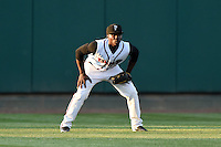 Lansing Lugnuts outfielder D.J. Davis (8) during a game against the South Bend Silver Hawks on June 6, 2014 at Cooley Law School Stadium in Lansing, Michigan.  South Bend defeated Lansing 13-5.  (Mike Janes/Four Seam Images)